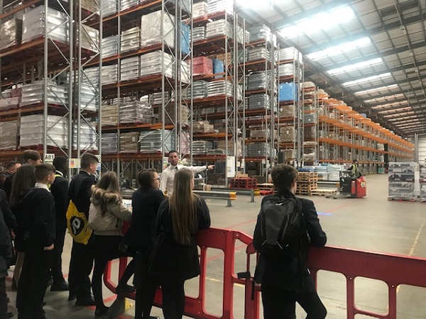 Group on tour of warehouse
