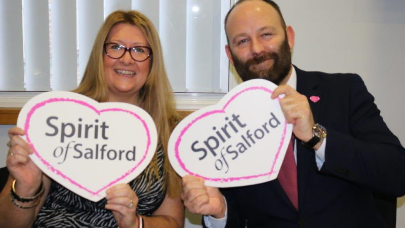 City Mayor and Emma Nolan holding Spirit of Salford cards