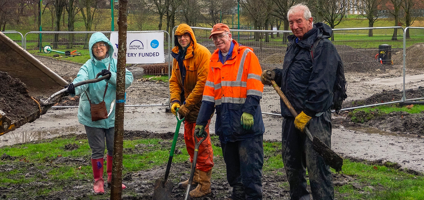 Volunteers helping to plant trees